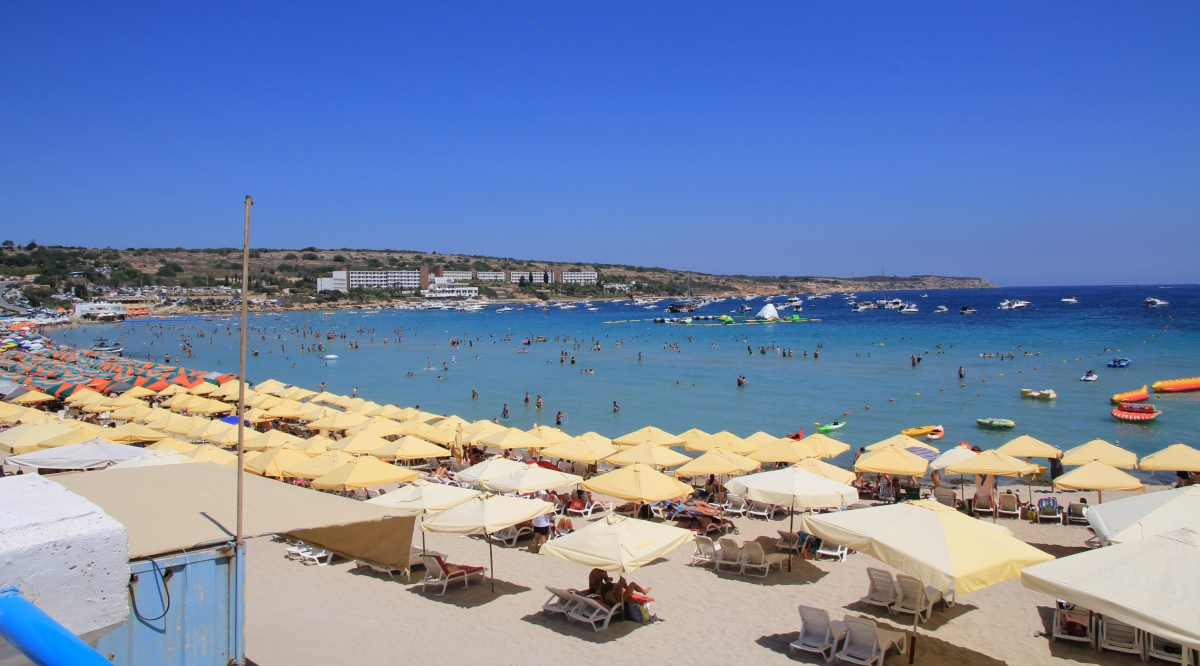 """Mellieha Bay beach Malta 1"" by Karelj - Own work. Licensed under CC BY-SA 3.0 via Wikimedia Commons - https://commons.wikimedia.org/wiki/File:Mellieha_Bay_beach_Malta_1.jpg#/media/File:Mellieha_Bay_beach_Malta_1.jpg"
